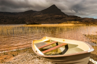 The sunny lonely boat in Assynt